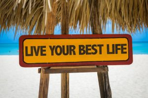 61280582 - wooden sign board in beach with text: live your best life