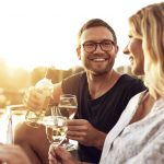 54832512 - man and woman drinking wine outside a summer day